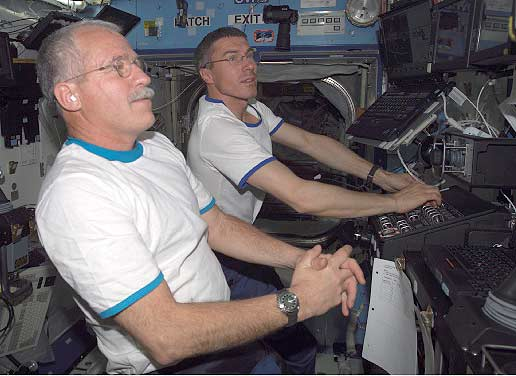 Sergei Krikalev and John Phillips practice with the Canadarm2 controls. Image credit NASA
