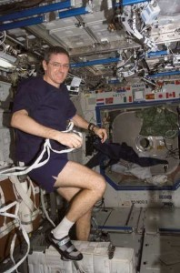 William McArthur exercises on the stationary bicycle. Image credit Aero News Network