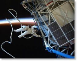 Handstand in space, just as the sun is rising.