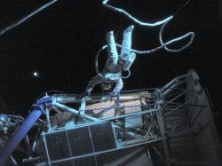 A Skylab crew member doing a handstand