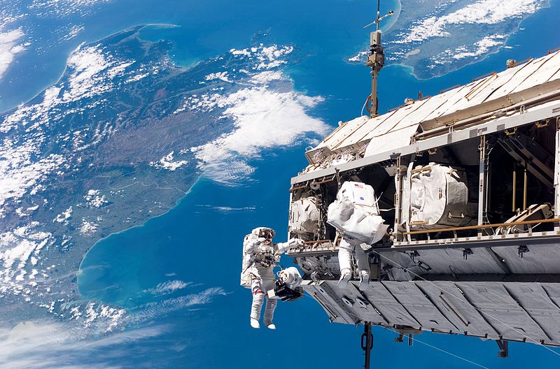 Christopher Fugleson and Robert Curbeam during the first EVA. Image credit Wikimedia