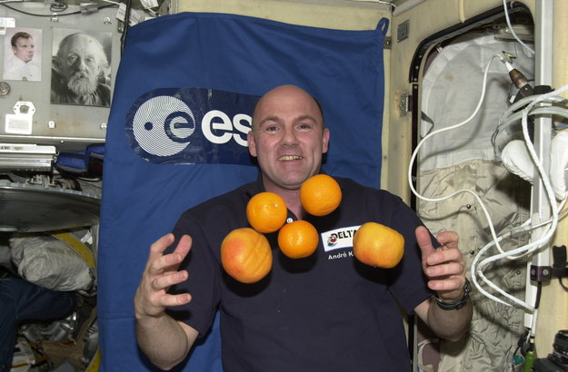 Andre Kuipers has some fun with some fresh fruit during his Delta Mission. Image credit European Space Agency
