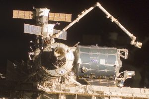 Canadarm2 is used to attach Columbus to the International Space Station. Image credit Logos In Space