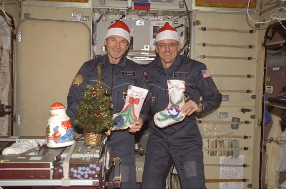 The Expedition 12 crew celebrates Christmas. Image credit Armagh Planetarium