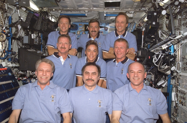 Expedition 13 and STS-115 Crews. Image credit Stock Photography