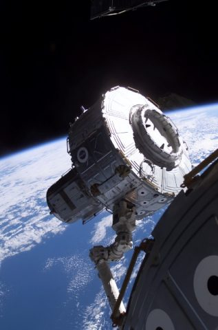 Canadarm2 is used to maneuver Quest into position. Image credit NASA