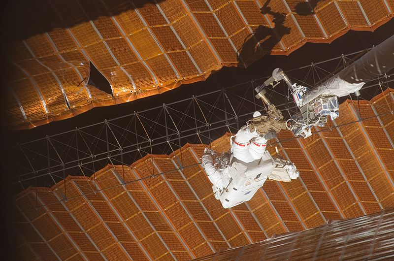 Now this is why astronauts are cool. Scott Parazynski risks 100 volts of electricity to make a critical repair to a Solar Array Wing. Image credit NASA