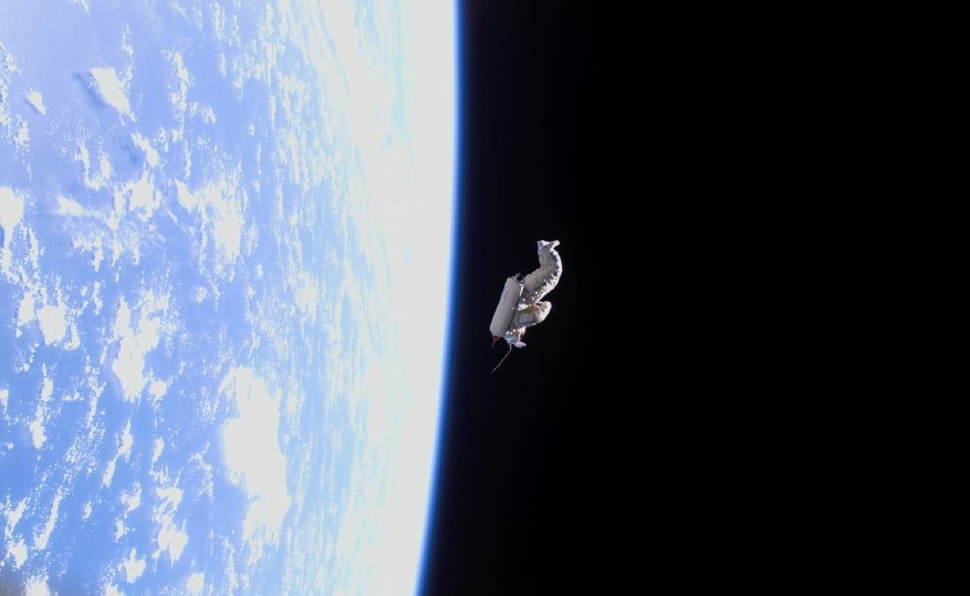 A lonely EVA suit is turned into a satellite transmitting greetings to Earth. Image credit Space Today