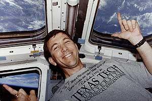 Rick Husband poses in a Texas Tech T-shirt while in orbit. Image credit Texas Tech