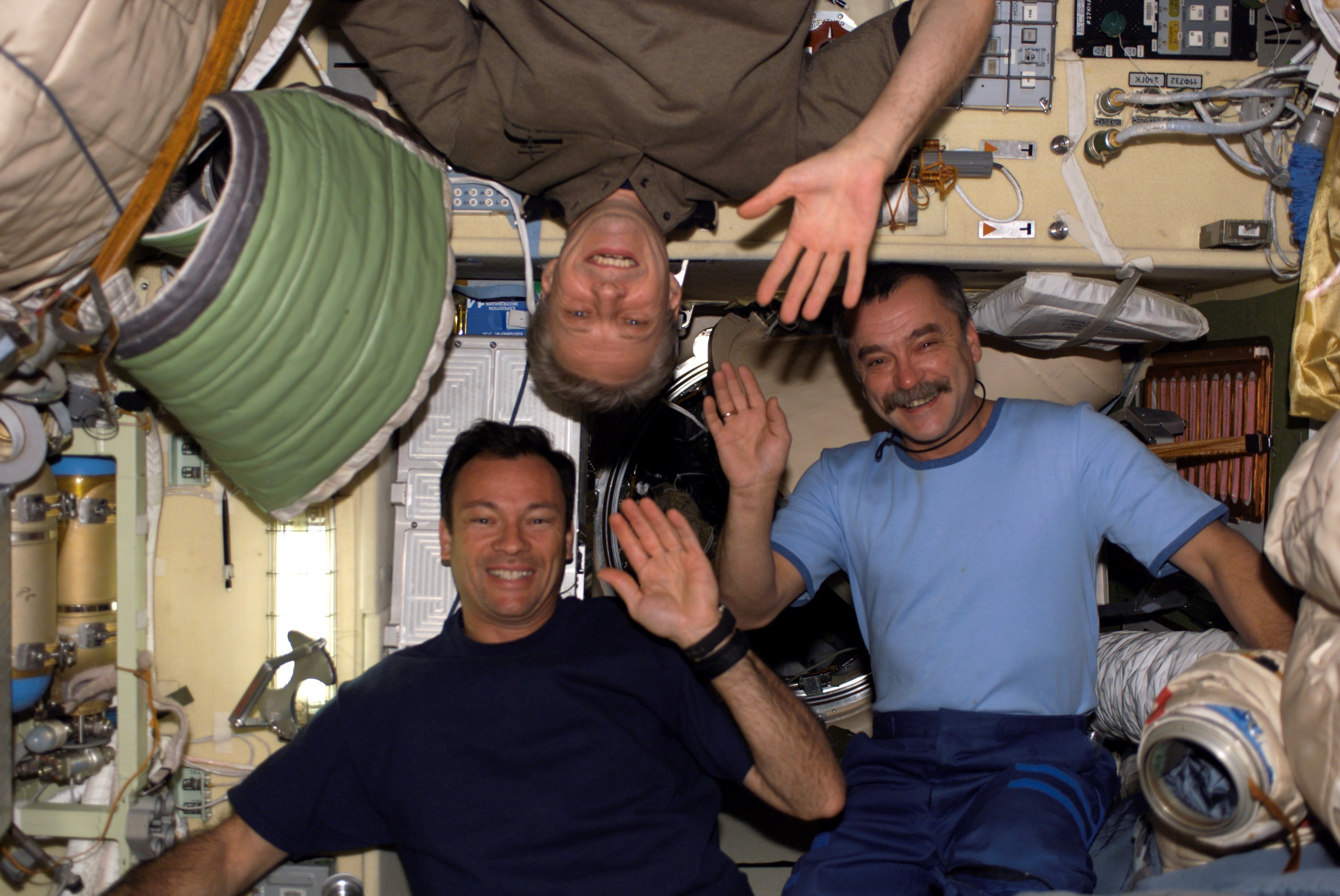 Thomas Reiter, Michael Lopez-Alegria and Mikhail Tyurin post for a picture. Image credit ESA