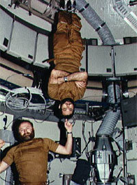 In microgravity, an astronaut can use another one as a dumbbell. Image credit NASA
