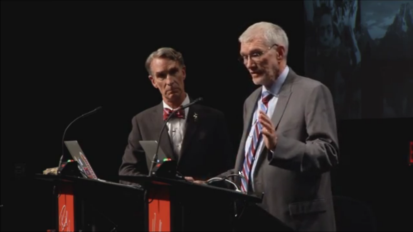 Bill Nye watches Ken Ham answer a question. Image credit Youtube