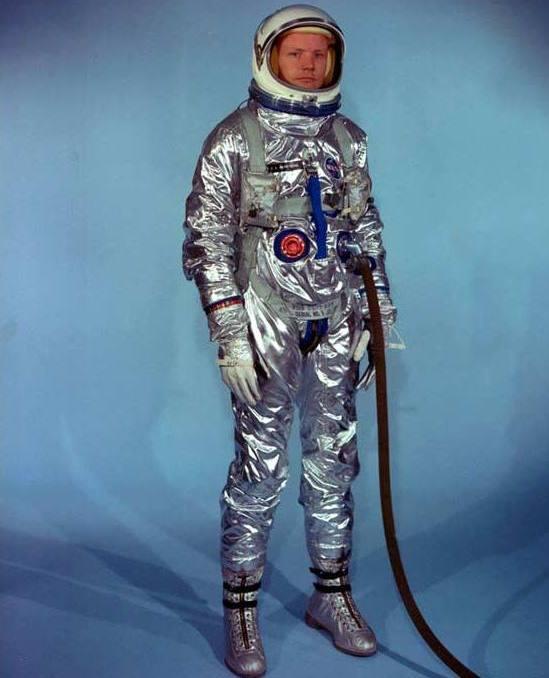 A Mercury pressure suit modeled by John Glenn, for comparison
